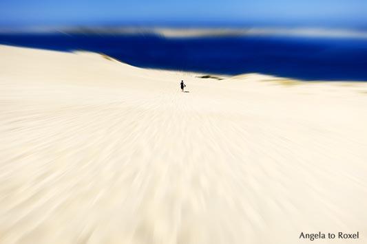 Woman running down Dune du Pilat, blur, La Teste-de-Buch, Arcachon, Nouvelle-Aquitaine, France 2012