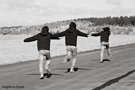 Young man running on runway, composing - Flughafen Höxter-Holzminden 2014